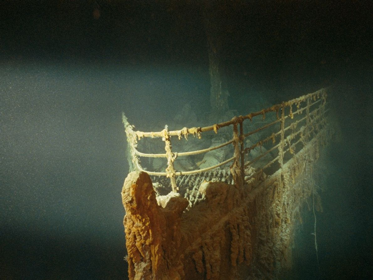 A submersible's lighting gives a ghostly glow to the rusted prow of the R.M.S. Titanic. The ...