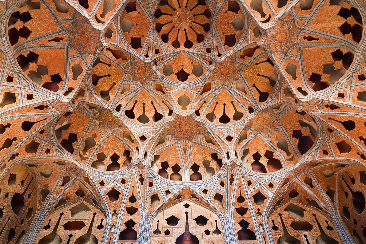A view of the intricate ceiling of the Music Hall in Iran's Ali Qapu grand palace. ...