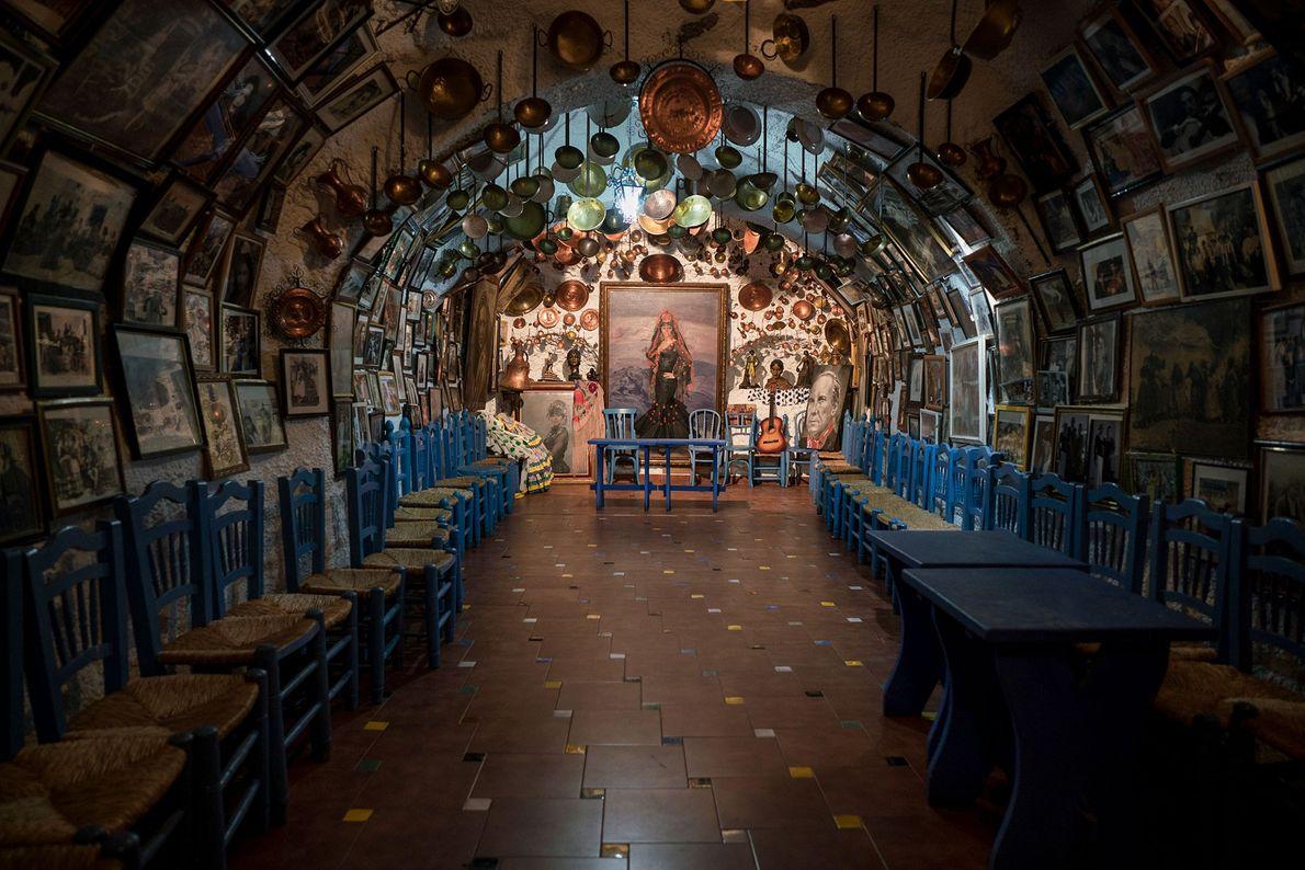 Lights shine inside the cave where flamenco dancers perform every evening. A similar dance was a ...