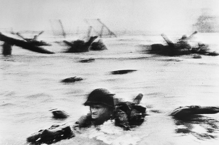 War photographer Robert Capa accompanied the first wave of troops as they faced enemy fire and ...