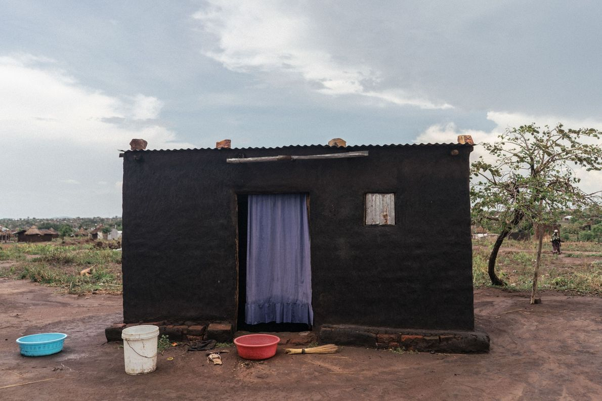 A purple drape covers the front doorway of a home in a Northern Ugandan refugee settlement.