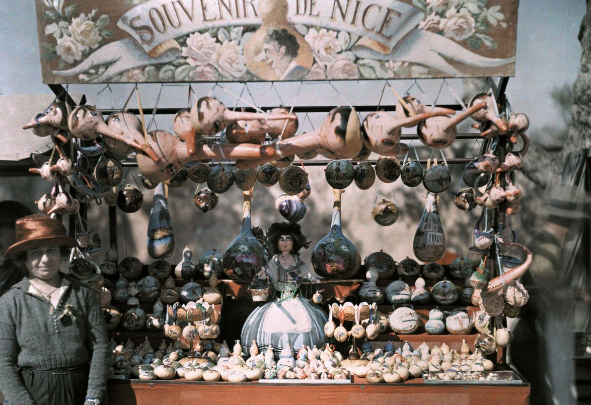 A vendor hawks souvenirs during high tourist season at the French Riviera.