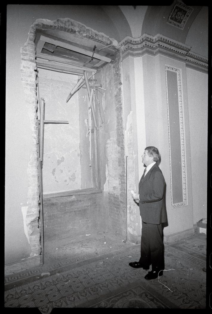 Sen. Mack Mattingly, R-GA, looks at a 13-foot hole torn by a bomb that exploded 30 ...