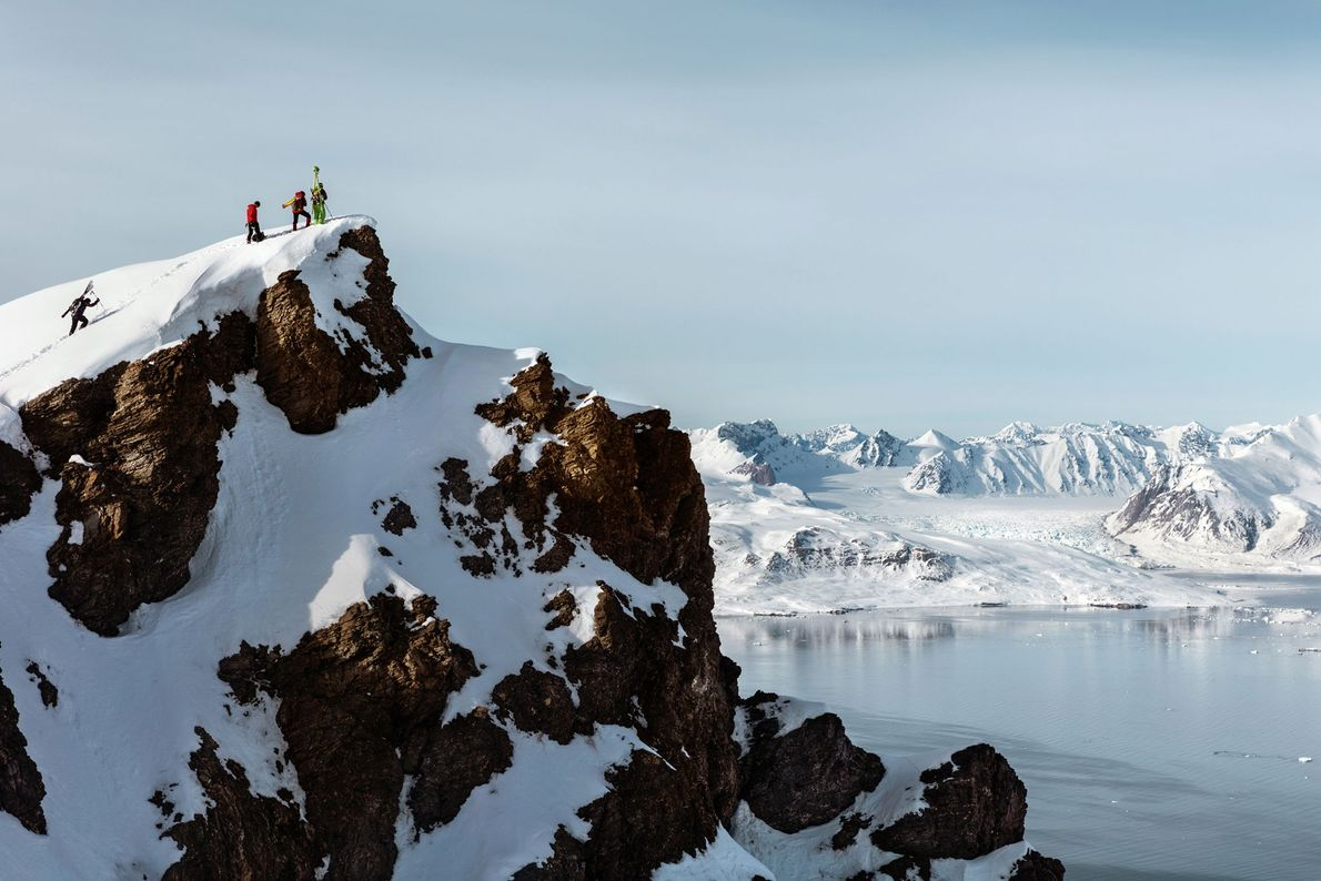 French and Austrian glaciologists haul laser-scanning equipment to a ridge overlooking a glacier they are about ...
