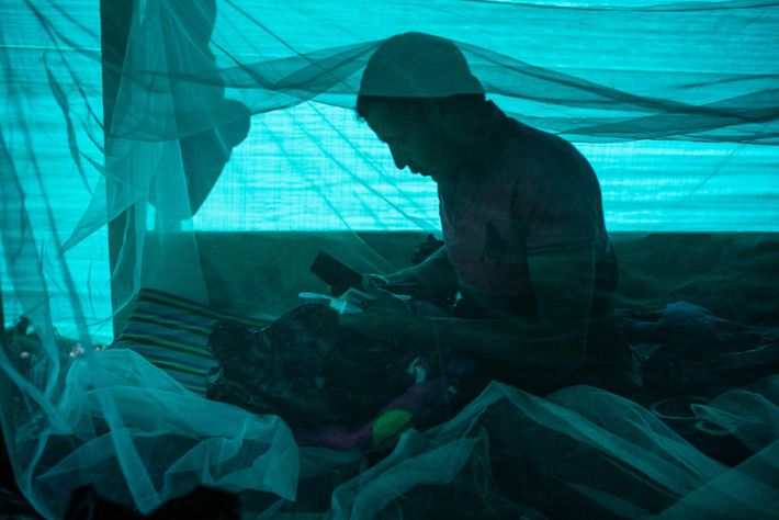 Jorge Blanco Escobar prepares his equipment inside his barrack at the expedition camp. Blanco Escobar is ...