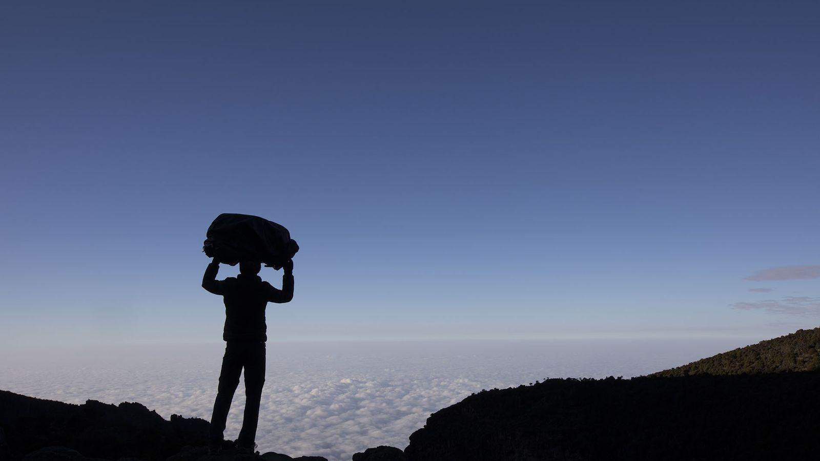 Crista Cullen stands atop Mount Kilimanjaro