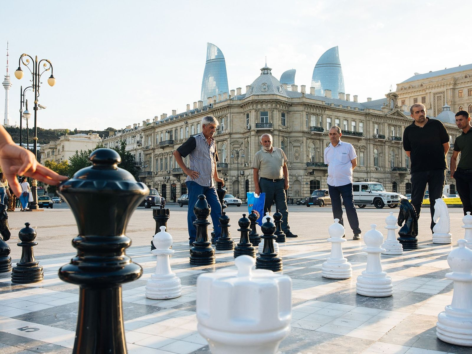 Men playing chess on a giant board in Azneft Square, near the Bulvar.
