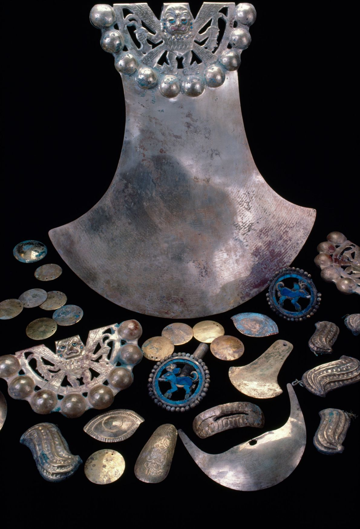 An array of gold objects found in the tomb of a Moche warrior-priest known as the ...