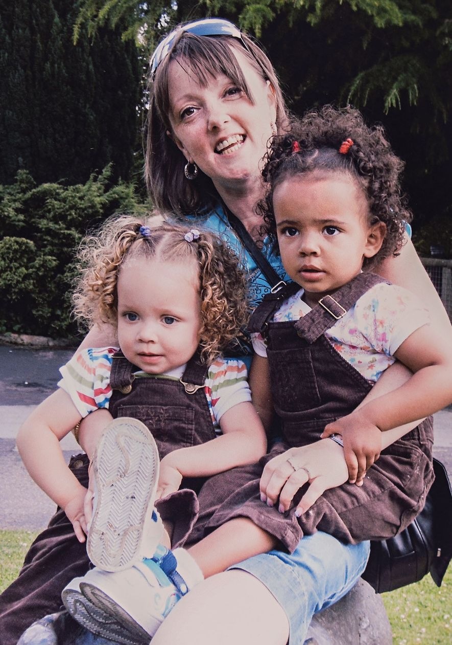 Even when the twins' mother, Amanda Wanklin (above), dressed them alike, there was no mistaking one ...