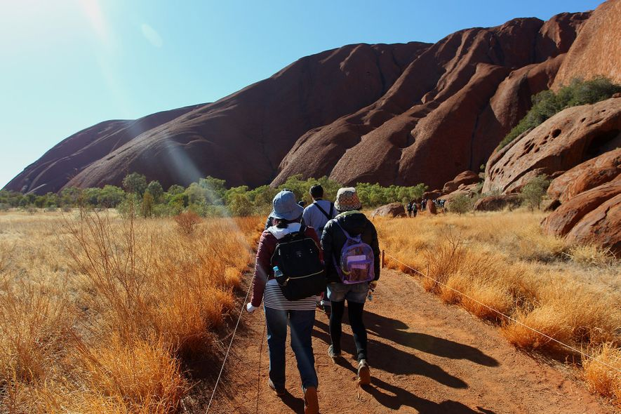 Though Uluru–Kata Tjuta National Park experienced a surge in visitors after the climbing ban was announced, ...