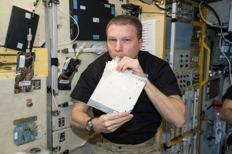 NASA astronaut Terry Virts takes a drink of his very first milkshake on board the International Space Station.