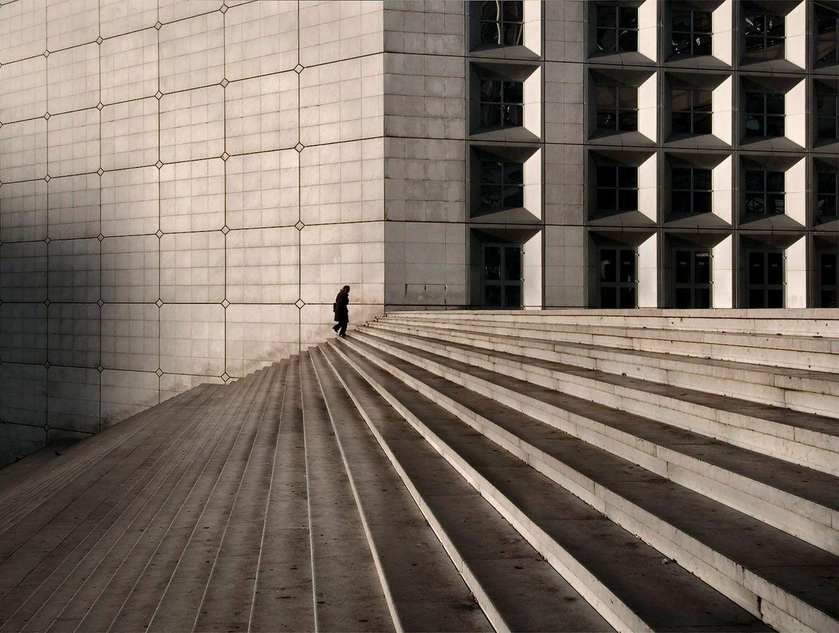A figure walks through La Grande Arche de la Défense, a monument designed to be a ...