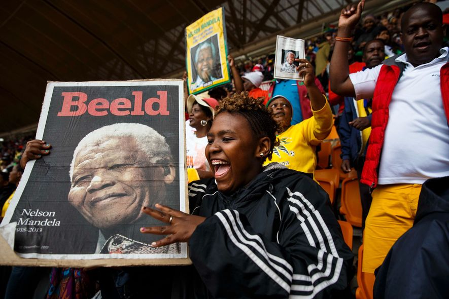 During a memorial service for former South African President Nelson Mandela, people young and old dance ...