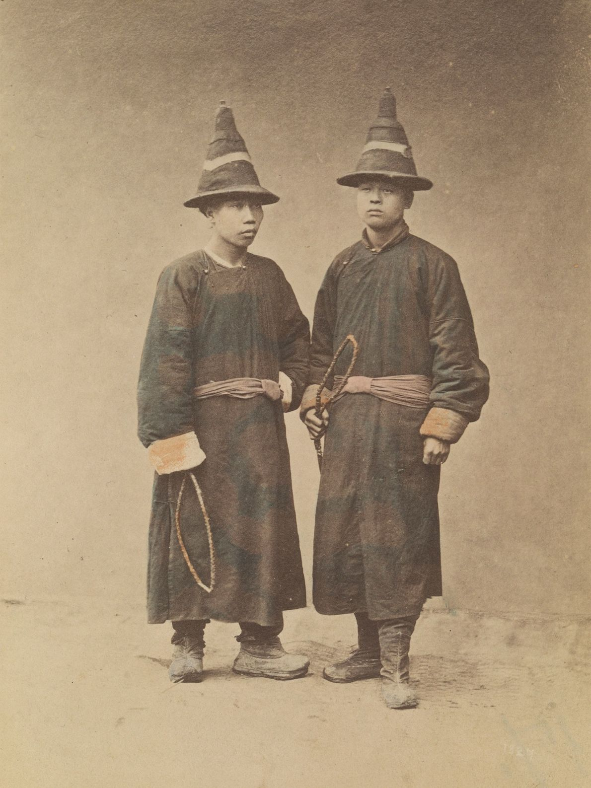 Runner boys from the late 1800s wear hats made of hardy fabric while working to catch ...