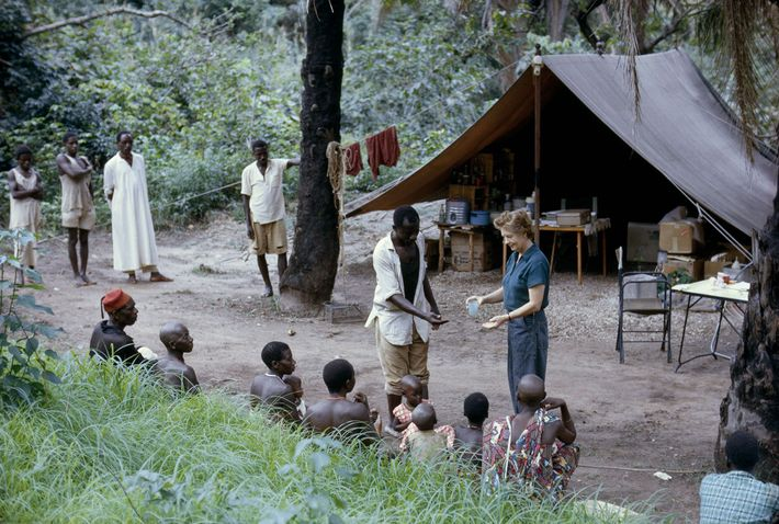 Sick call at camp finds the author's mother, Mrs. Vanne Morris-Goodall, dispensing aspirin.