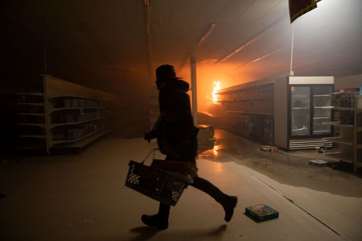 Protesters ransack a department store during ongoing demonstrations. Around 200 businesses in Minneapolis and St. Paul ...