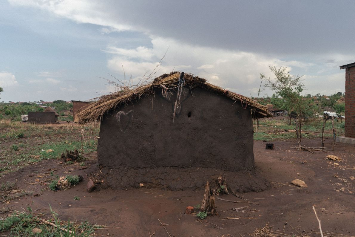 A straw roof tops a home made by a South Sudanese refugee.
