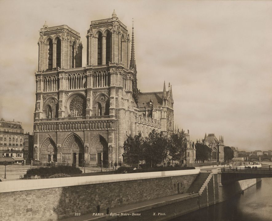 Seated on the Seine River, the Notre Dame Cathedral (shown here in the 1920s) has been ...