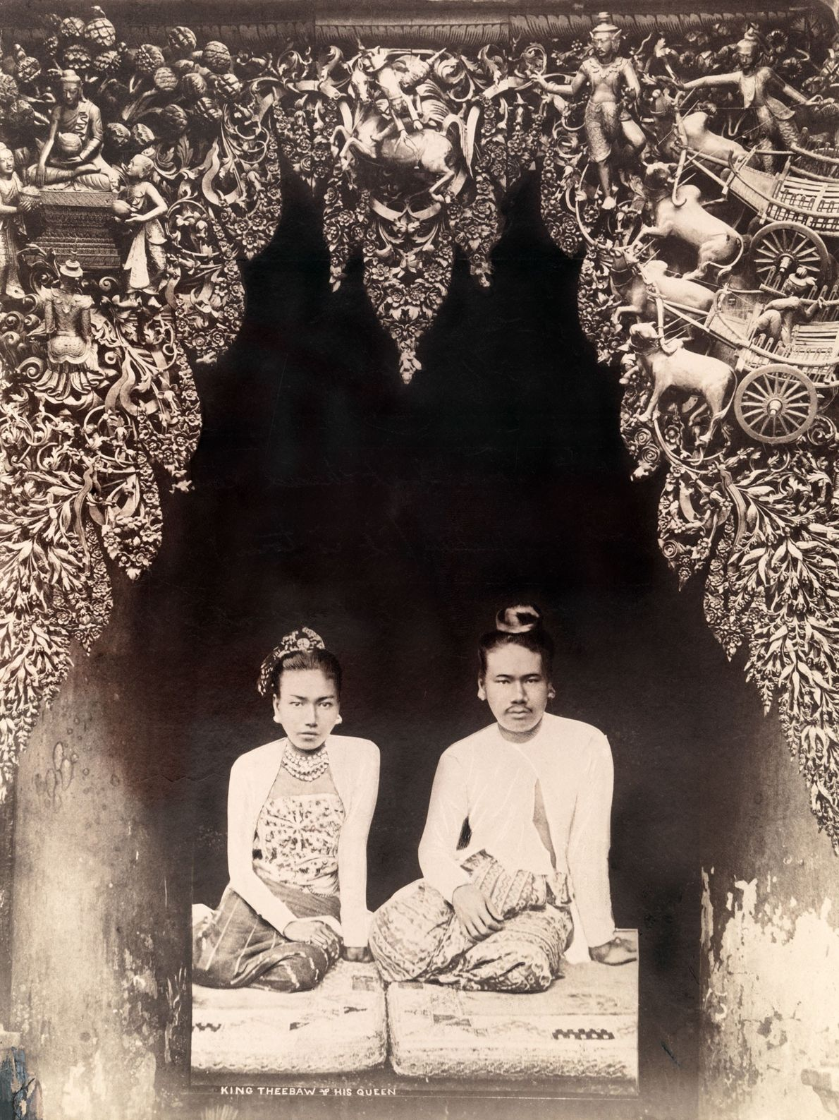 King Thibaw and Queen Supayalat, the last reigning monarchs of Burma (now known as Myanmar), sit ...