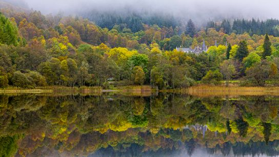 The still waters of Loch Achray make it an idyllic destination for fishermen and photographers alike.