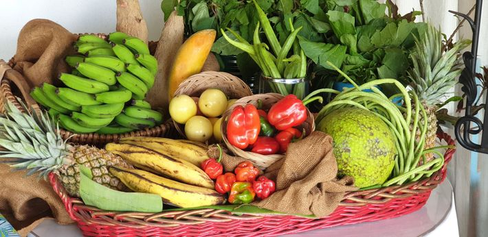 Stalls at Scarborough's local market sell a whole variety of fresh produce such as okra, callaloo leaves, ...