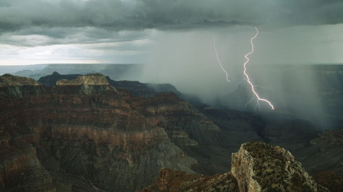 A dramatic cloudburst releases jagged bolts of lightning deep into the  Grand Canyon near Point ...