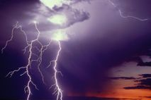Two large lightning bolts strike the ground near Las Cruces, New Mexico.  Though human eyes ...