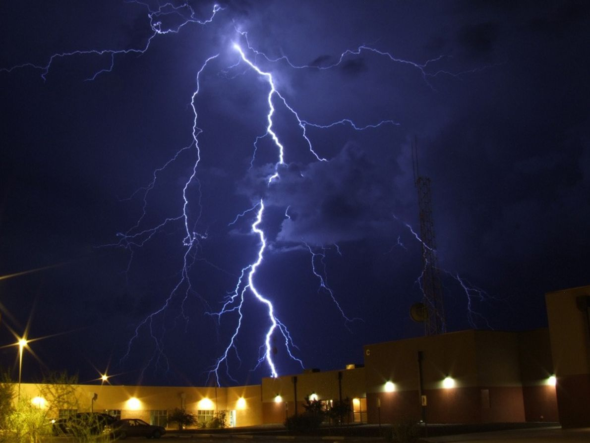 A thunderstorm passes behind the Cochise county courthouse in Arizona.  Despite being in a dry ...