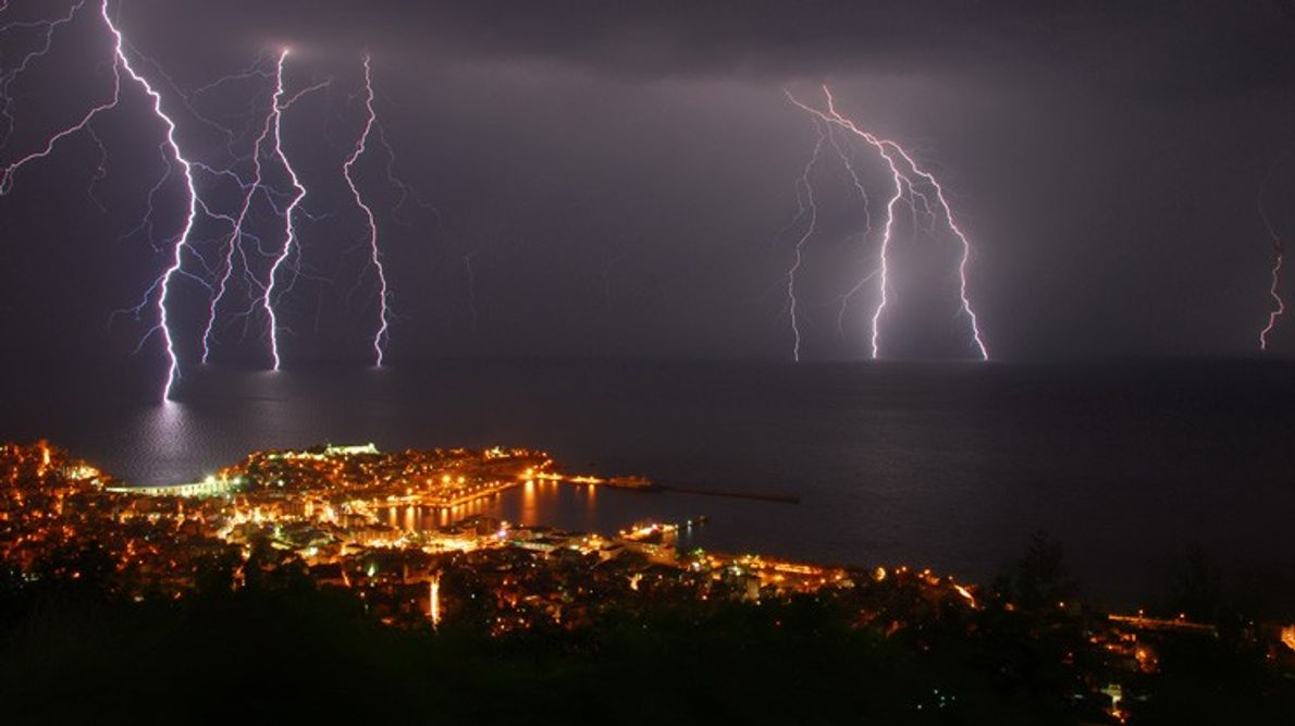 Several bolts of lightning strike the water off the coast of Kavala,  Greece. Lightning can ...