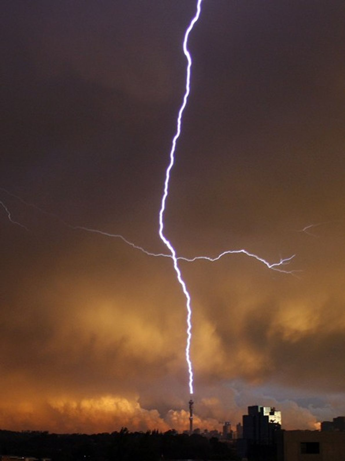 Tall towers are frequent targets of lightning strikes, because there is less air to act as ...