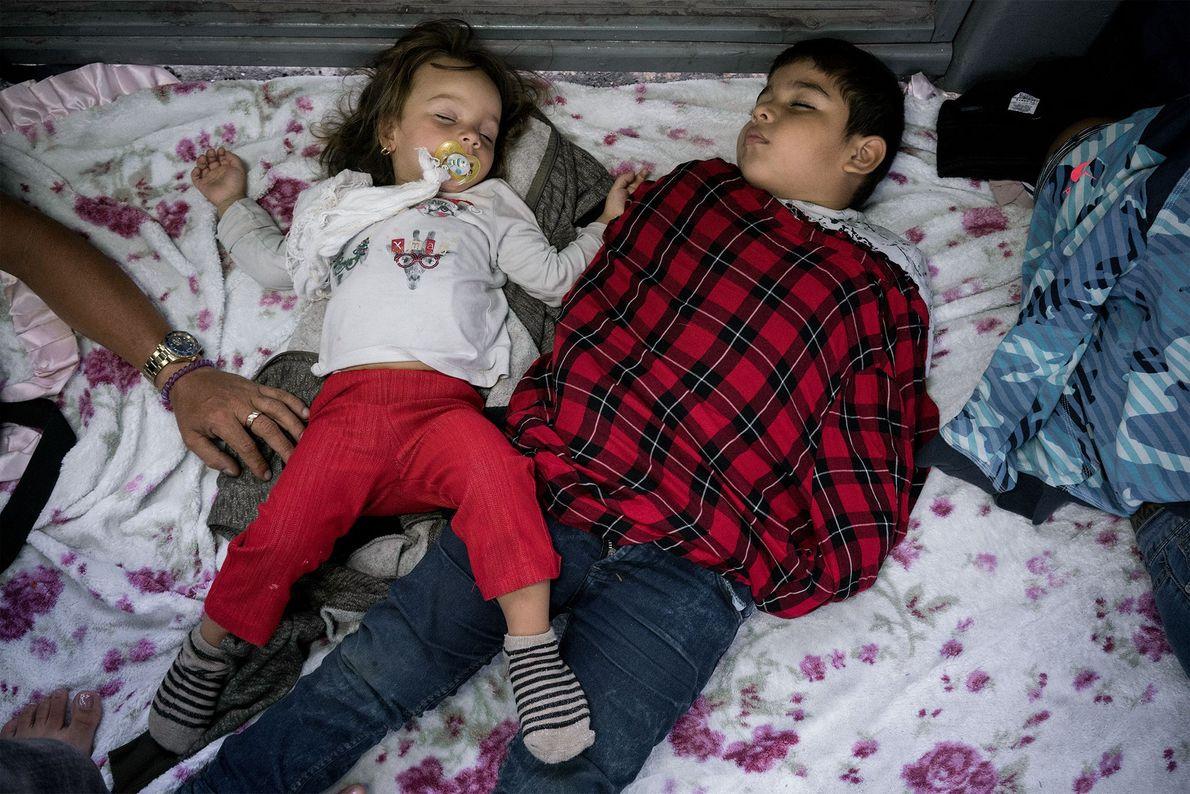 Two children sleep on the Gateway to the Americas International Bridge, waiting to be heard on ...
