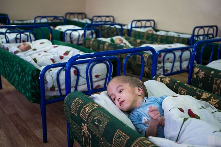Rustam Janabaev, 6, lies in his cot in a ward of the Children's Centre of Special ...
