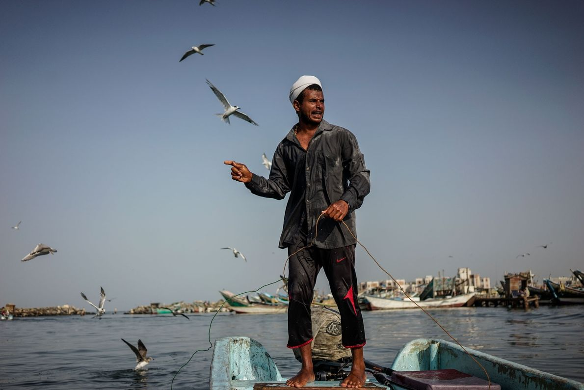 A fisherman prepares his boat in the Red Sea port of Hodeidah.