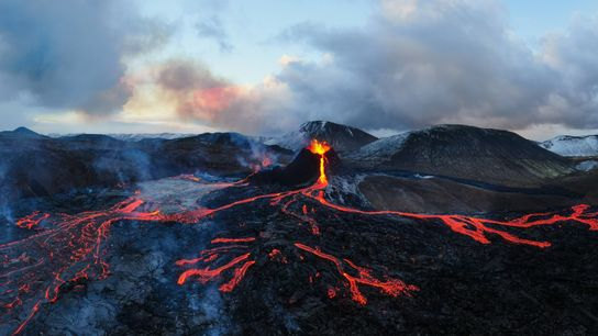 Like city lights from above, the evening glow cast by the lava flow creates a literal ...