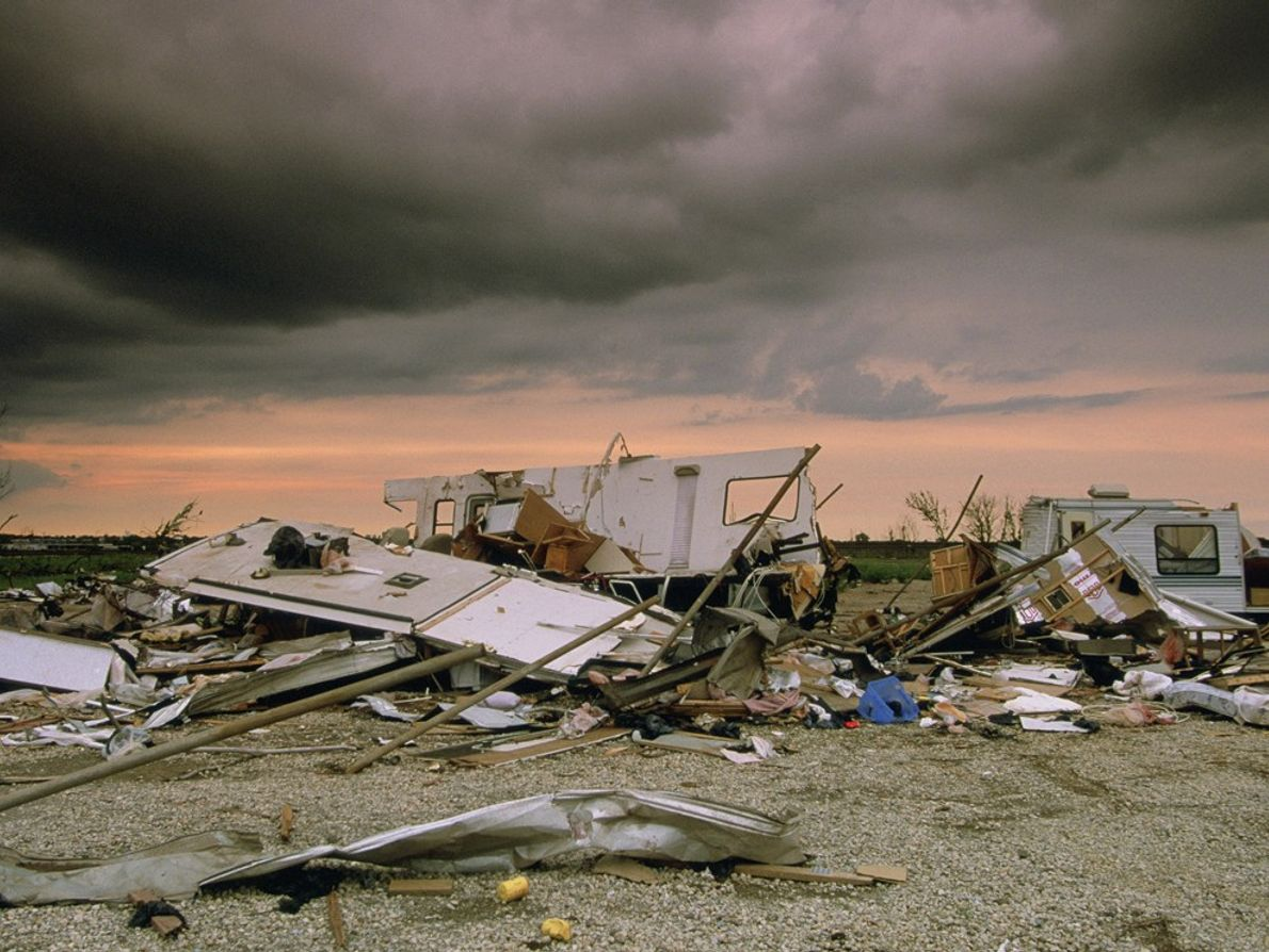 Storm-stained skies hover over the remains of a mobile home demolished by a passing tornado. Tornadoes ...