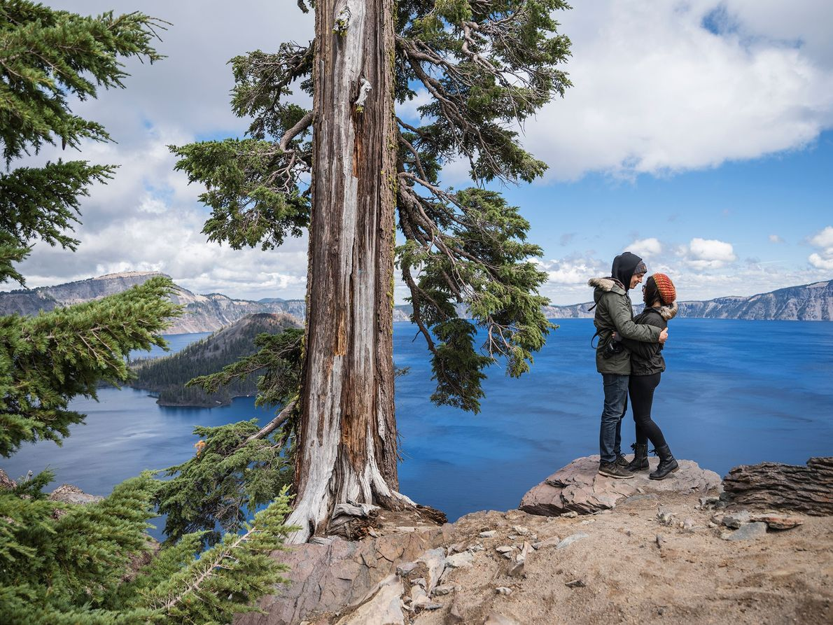 A couple embraces at Crater Lake in Oregon.