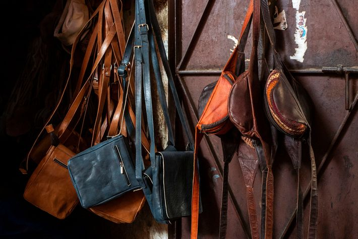 Leather shoulder pouch and bum bags for sale in an artisan workshop. Some of the craftsmen ...