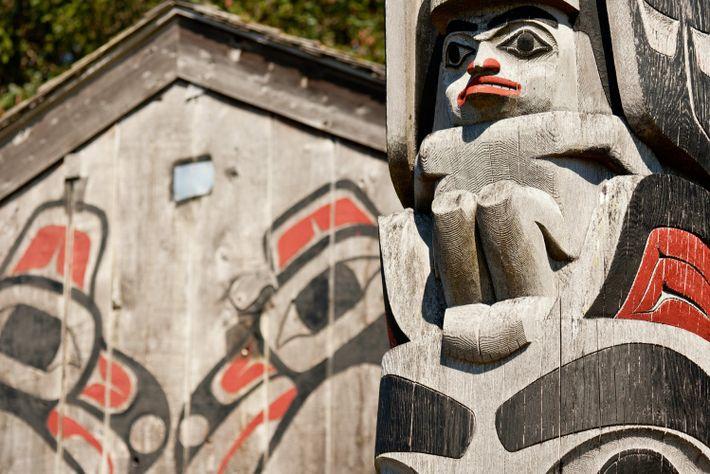 A cedar long house with traditional totem pole, Haida Gwaii.