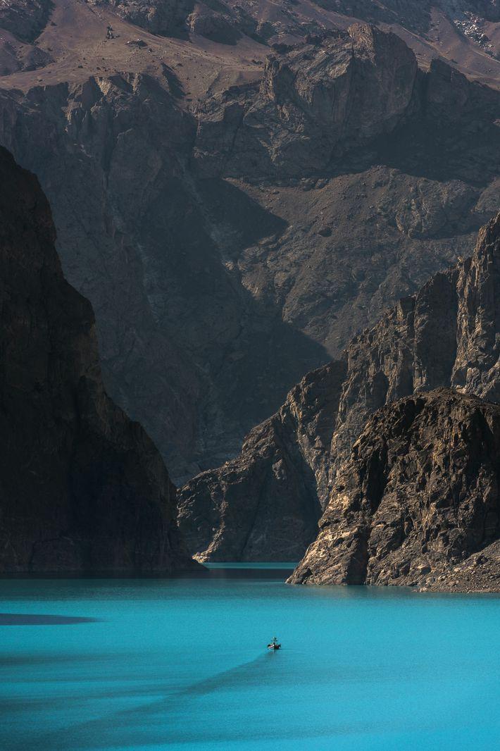 Navigating the turquoise waters of Attabad Lake, Karakoram.