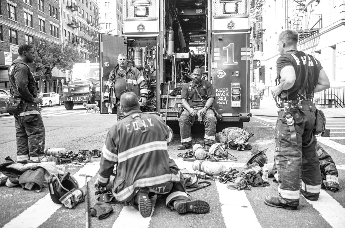 New York City firefighters take a moment after tackling a blaze in Manhattan's Upper West Side.