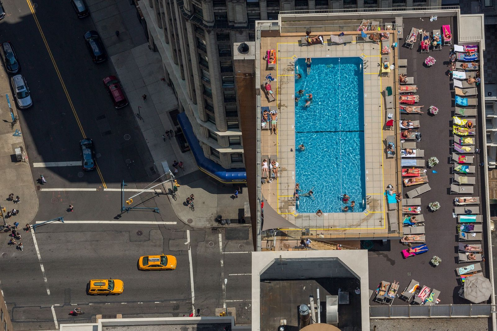 In the summer of 2014, New Yorkers escape the urban heat island in a rooftop pool ...