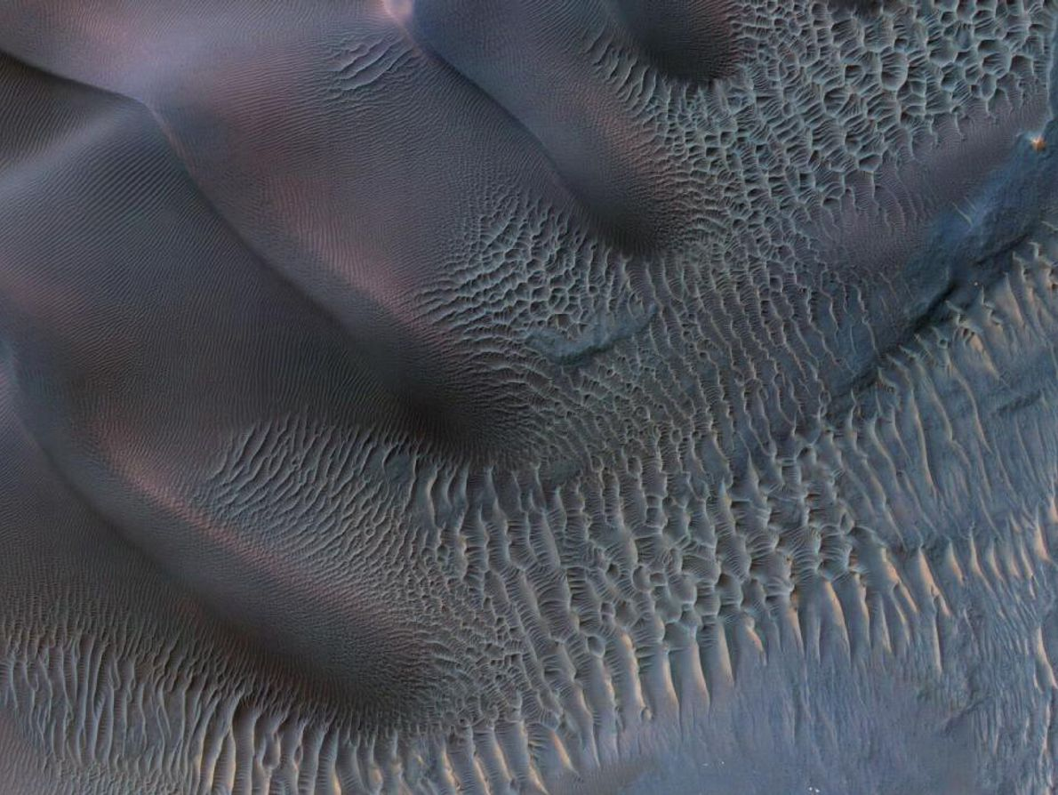 Sand dunes are among the most widespread wind-formed features on Mars. Their distribution and shapes are ...