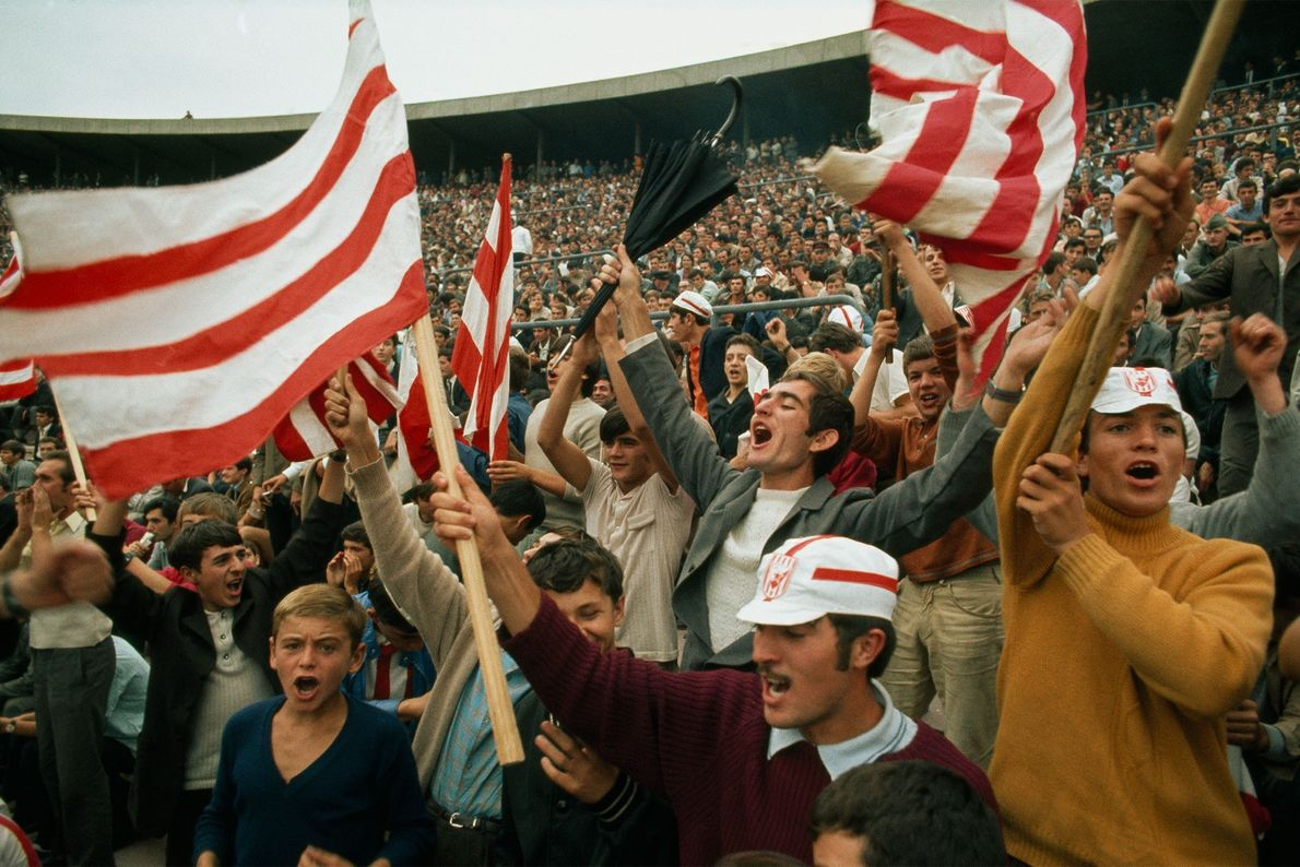 During a 1970 football game in Serbia, Yugoslavia, fans cheer as Yugoslavia scores against Ireland.