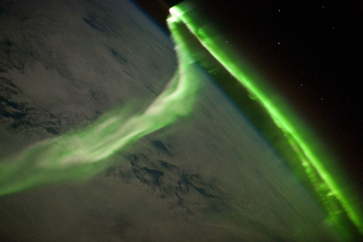 During a geomagnetic storm, a neon green ribbon of aurora australis danced over Earth in this ...