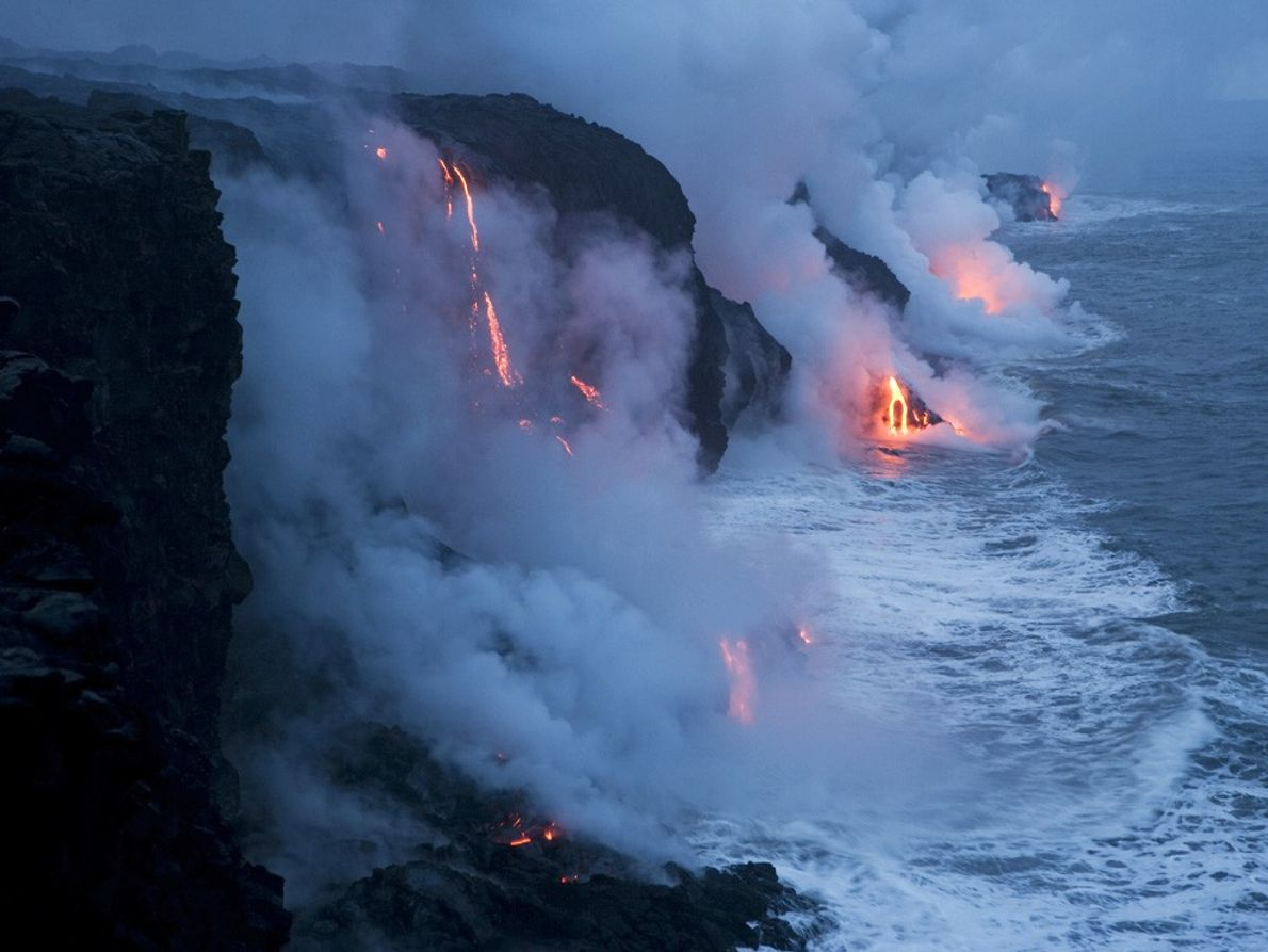 With  a hiss of steam, lava flows into the Pacific Ocean in Hawaii Volcanoes  ...