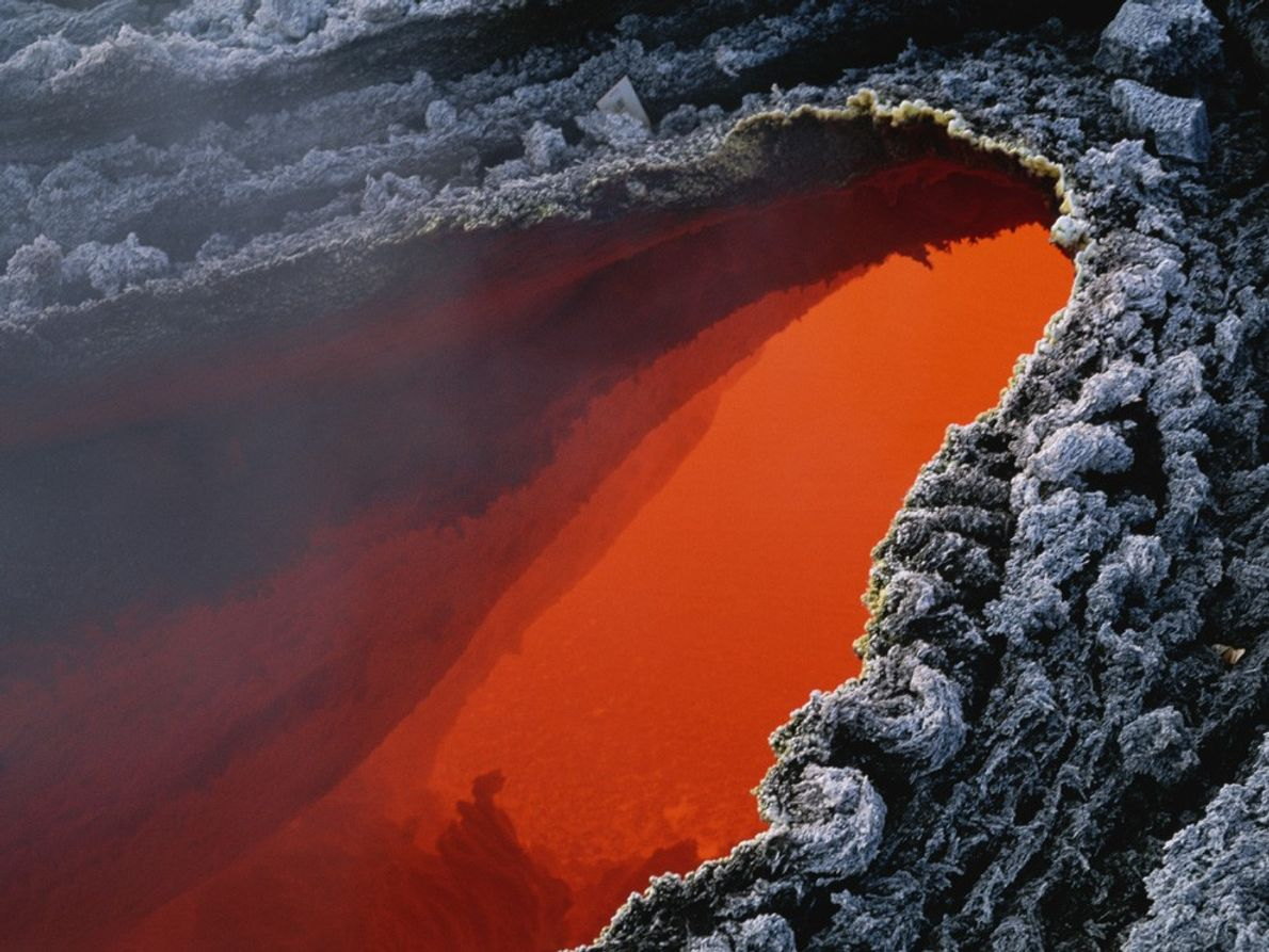 A few hundred degrees separates this pool of fiery orange magma in Italy's  Mount Etna …