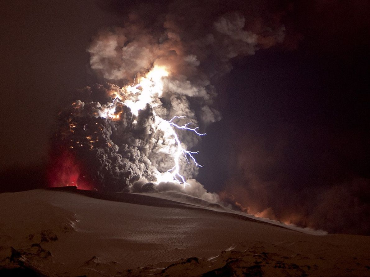 A bright bolt of lightning crackles within the ash cloud from the  eruption of the ...