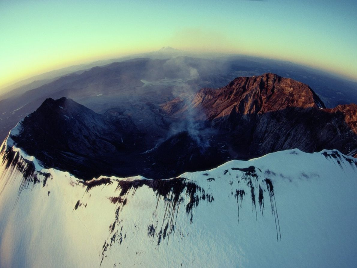 A wisp of  smoke escapes from Mount St. Helens' dramatic eggshell-shaped crater after an eruption. ...