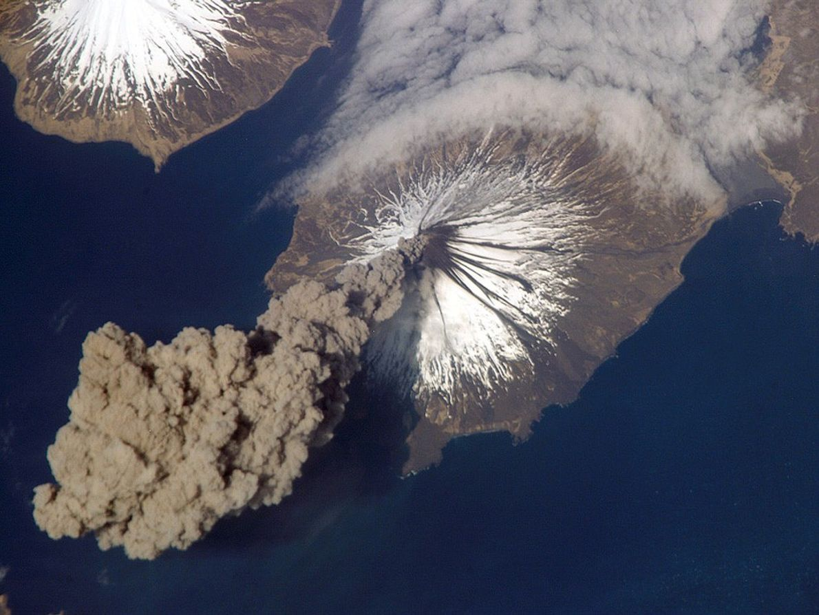 Cleveland Volcano releases a plume of ash that rises almost 6,000 metres (20,000 feet)  above ...