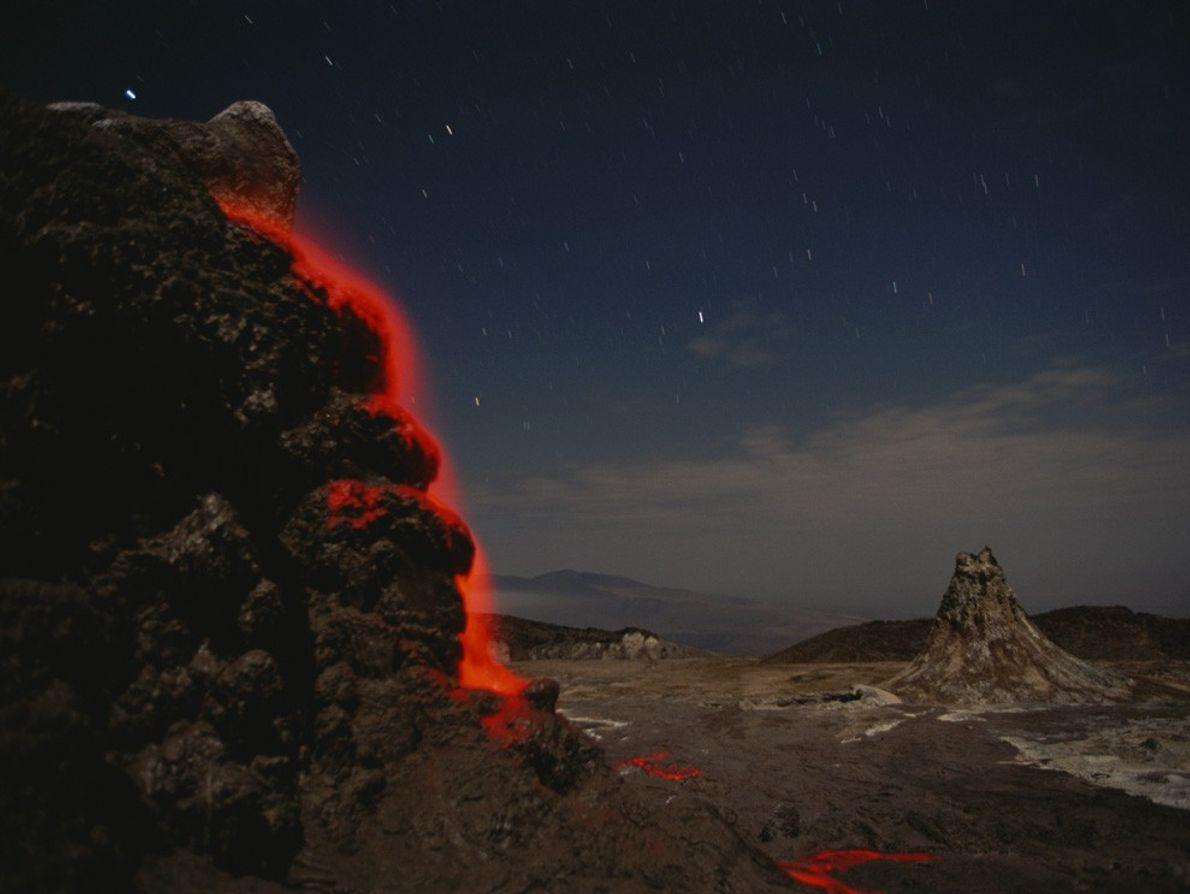 A stream of neon-orange lava cascades down Ol Doinyo Lengai, in Tanzania's  Great Rift Valley. ...